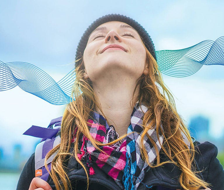 Woman expanding her lungs and breathing fresh air