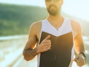 Man running with the sun shining behind him