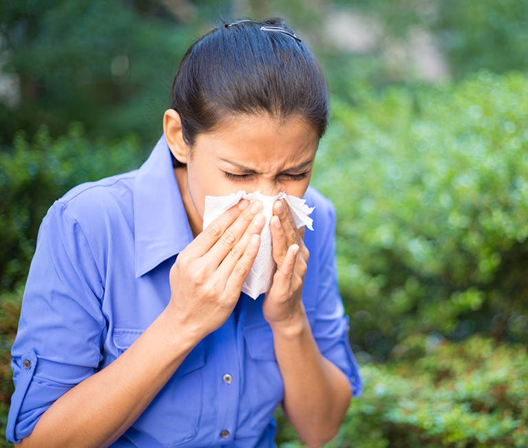 Woman is warming her nose and sinuses.