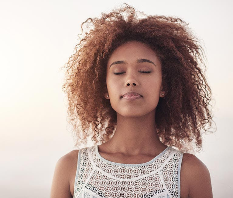 Woman relieved breathes in air
