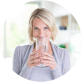 Woman Drinking Fiber Supplement