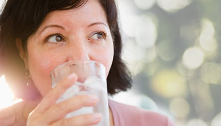 woman drinking ice cold water