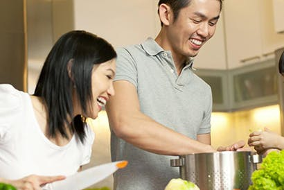 Family happily cooking together.