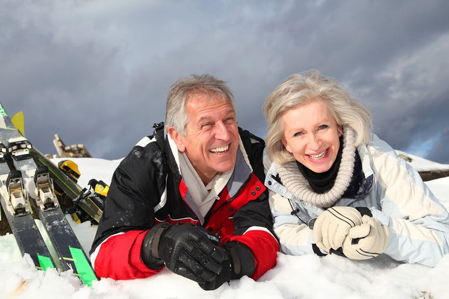 Couple laughing on snow thumbnail