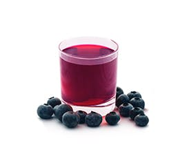 Sparking Blueberry-Ginger Lemonade in glass with fresh blueberry