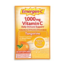 Box of Emergen-C Everyday Immune Support in Tangerine flavor with packet and water glass