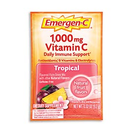 Box of Emergen-C Everyday Immune Support in Tropical flavor with packet and water glass