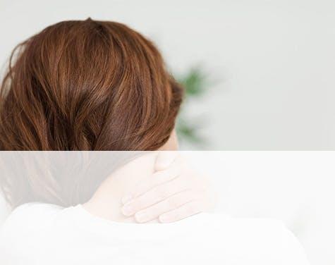women holding her neck
