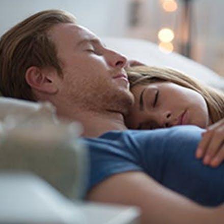 man and women sleeping