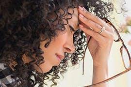 women holding her forehead