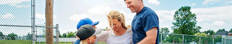 allergy free baseball family hugging outside