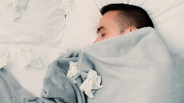 Man with cold or flu sleeping peacefully
