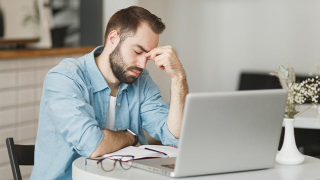 Man working from home drinking coffee