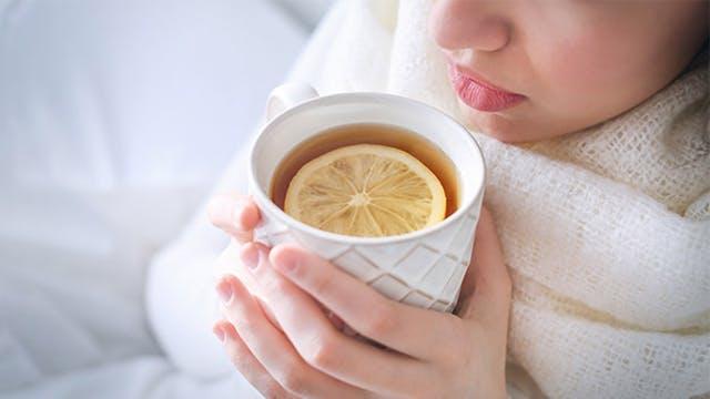 Woman drinking hot tea