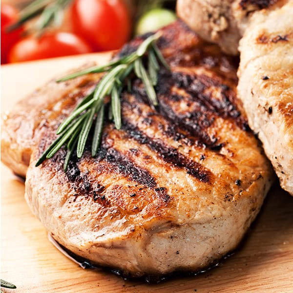 A close up of cooked pork chops.