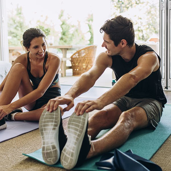 Man and woman stretching