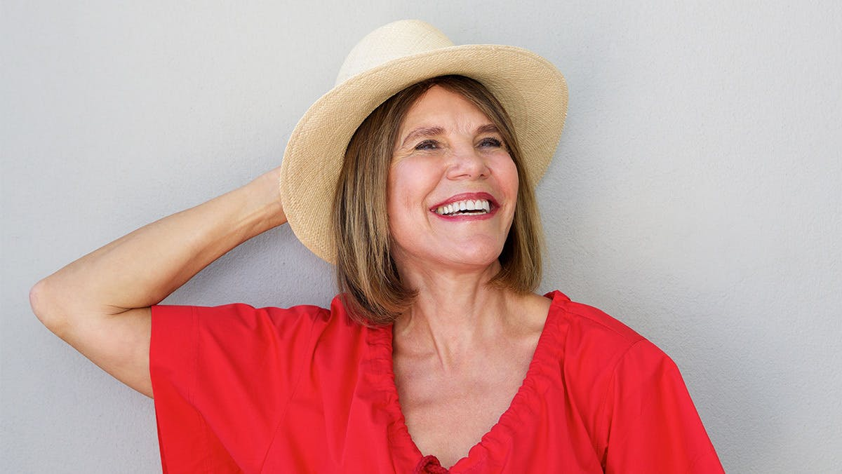 Healthy middle-aged woman laughing