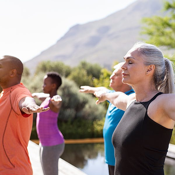 Group of people stretching outdoors