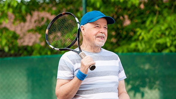 Middle-age man playing tennis