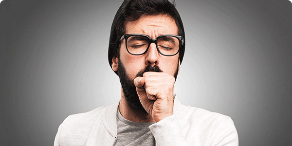 Man coughing from chest congestion
