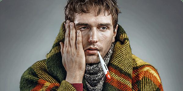 Man with flu symptoms taking his temperature