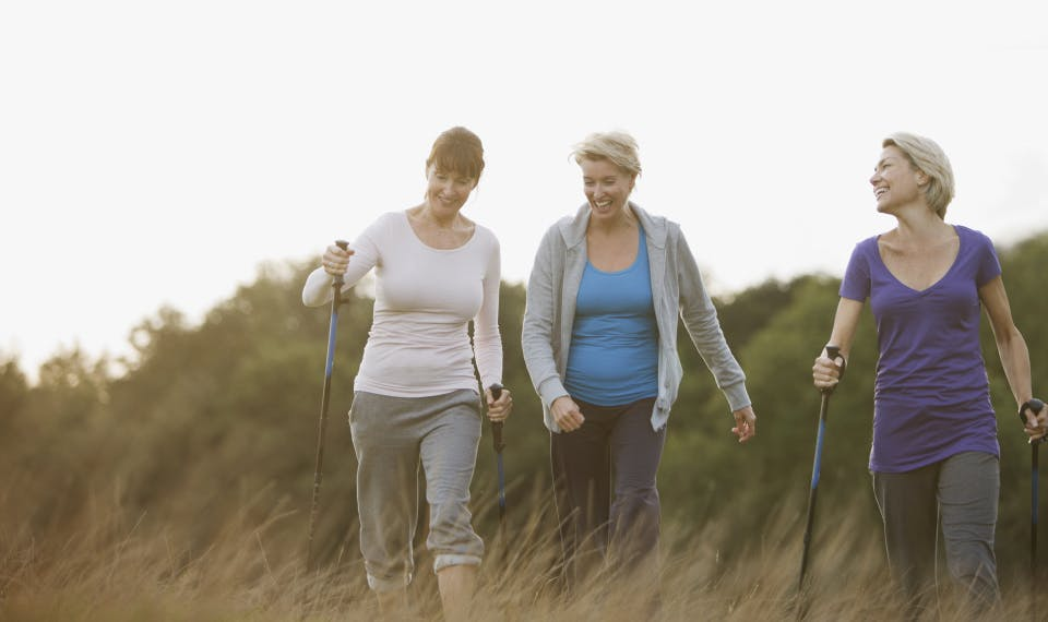 Woman walking with friends
