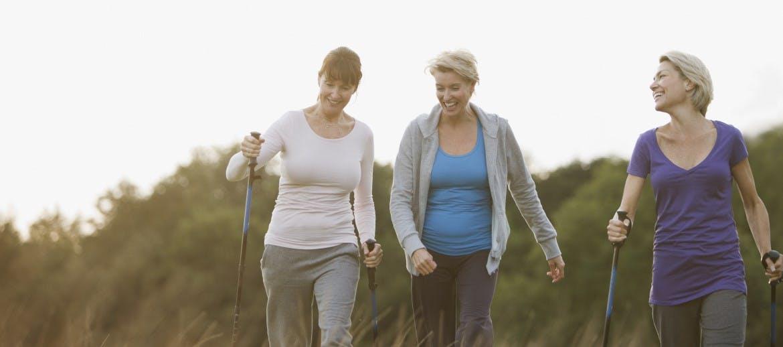 three women with walking poles