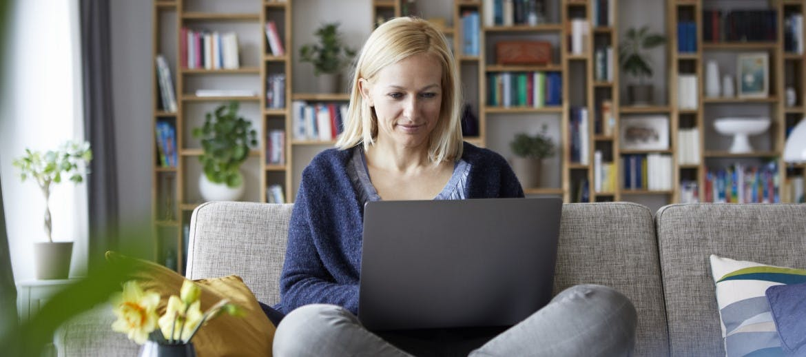 A women looking at a laptop