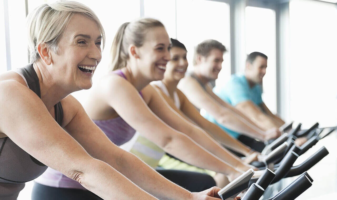 woman exercising with friends