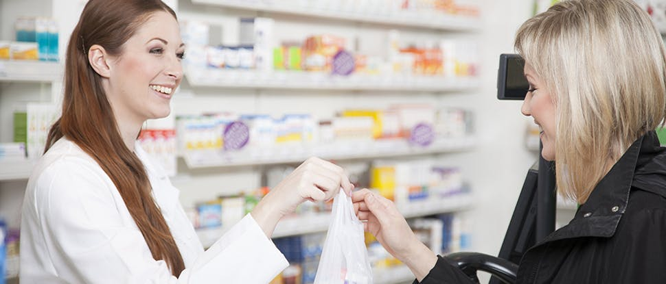 Pharmacist helping patient