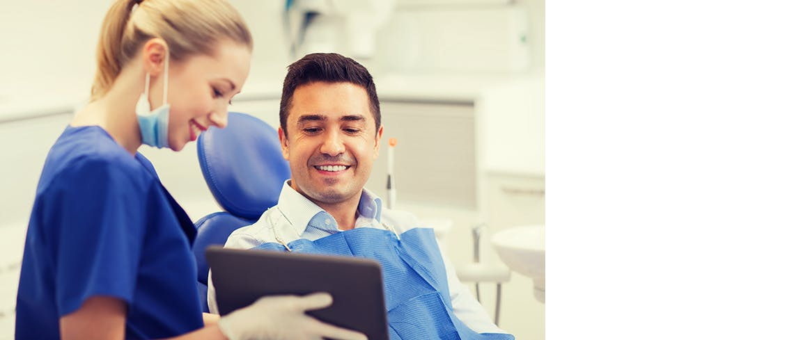 Dental professional with patient