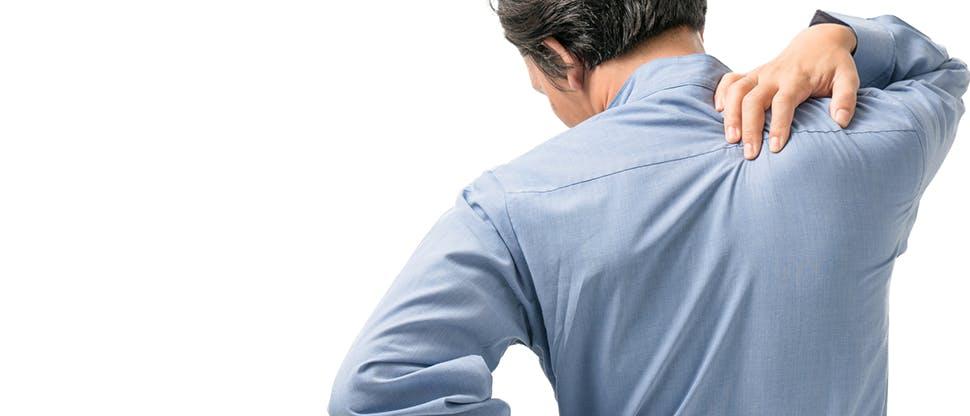 Man holding upper back