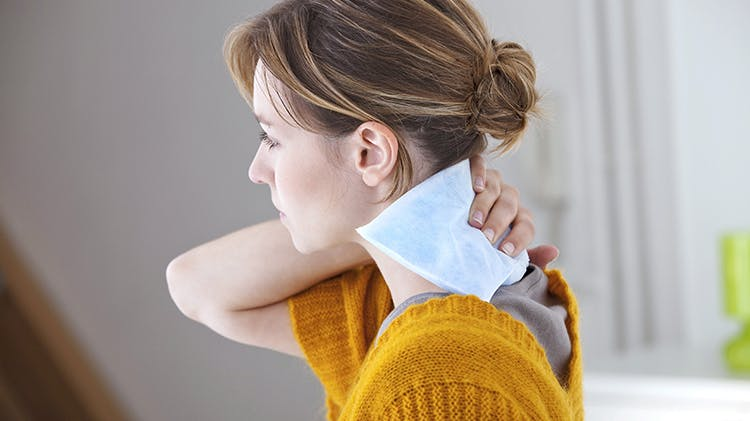 Woman with heat pack