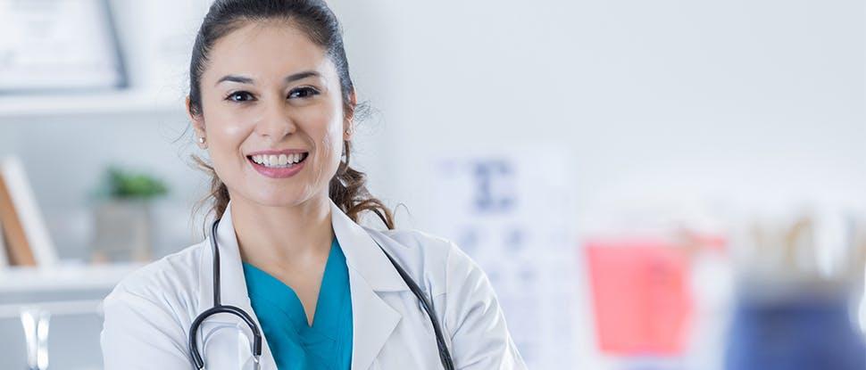 female clinician smiling