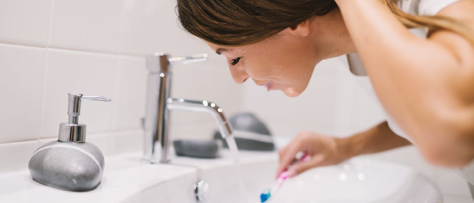 Woman rinsing mouth