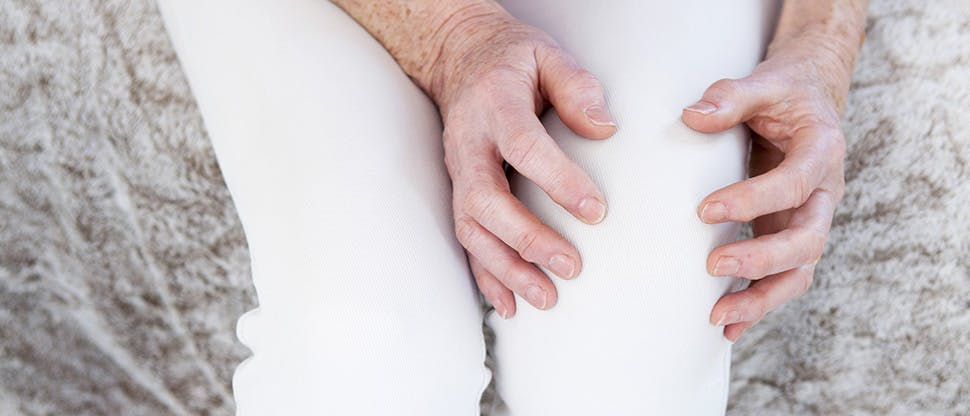 Woman holding knee