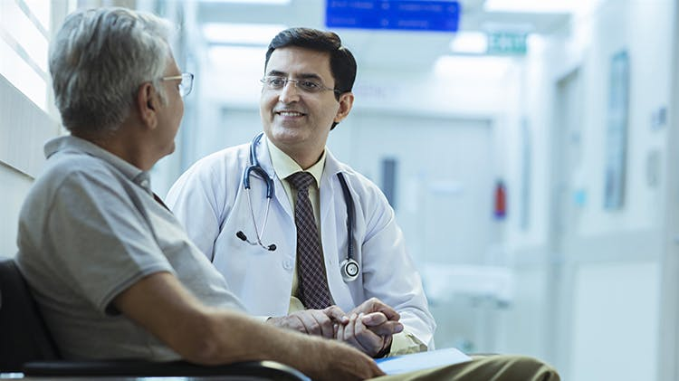 Man discussing with physician