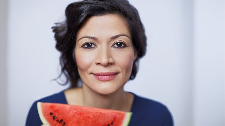 Woman with slice of watermelon