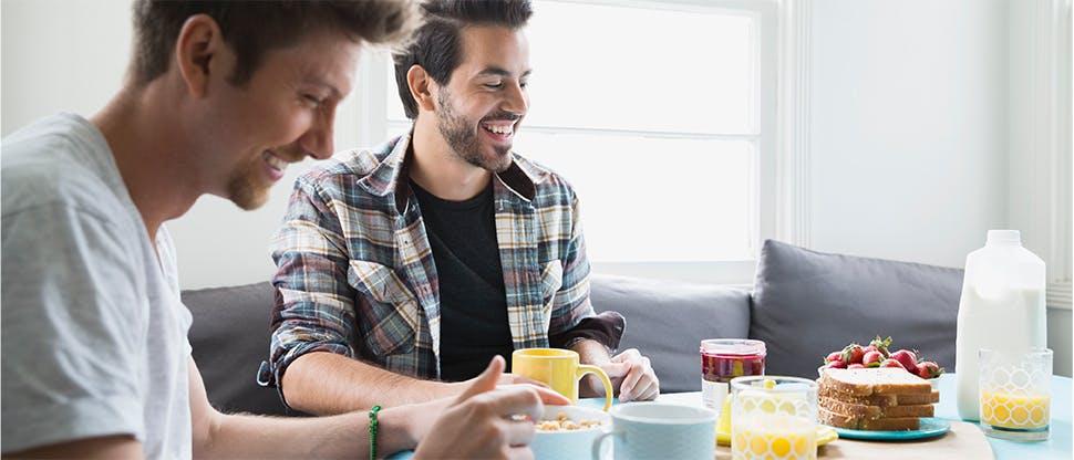Two men eating breakfast