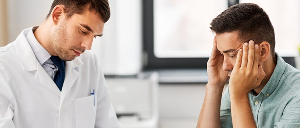 Doctor diagnosing someone with a headache