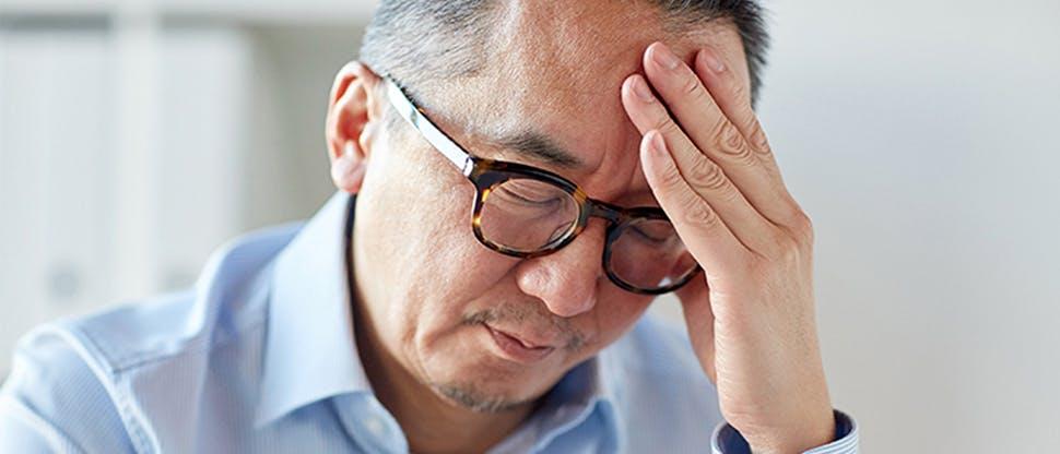 Man with a tension headache