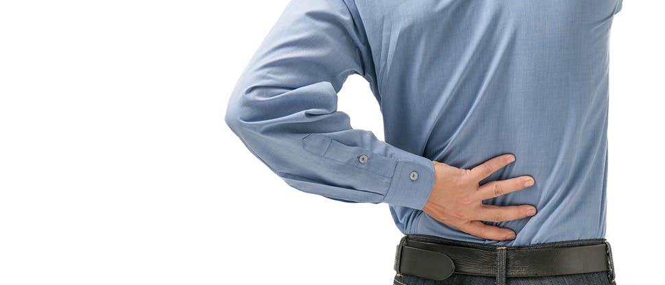 Man holding lower back