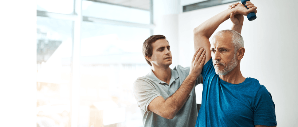 Physiotherapist doing checkup of the elbow of an older man