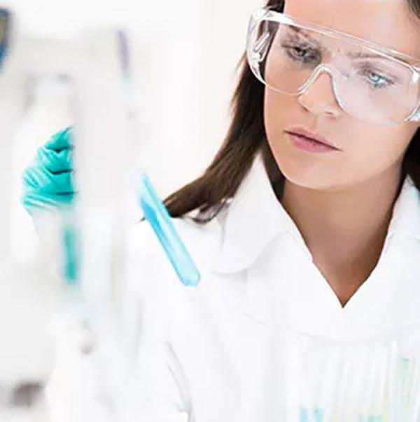 Scientist holding a beaker