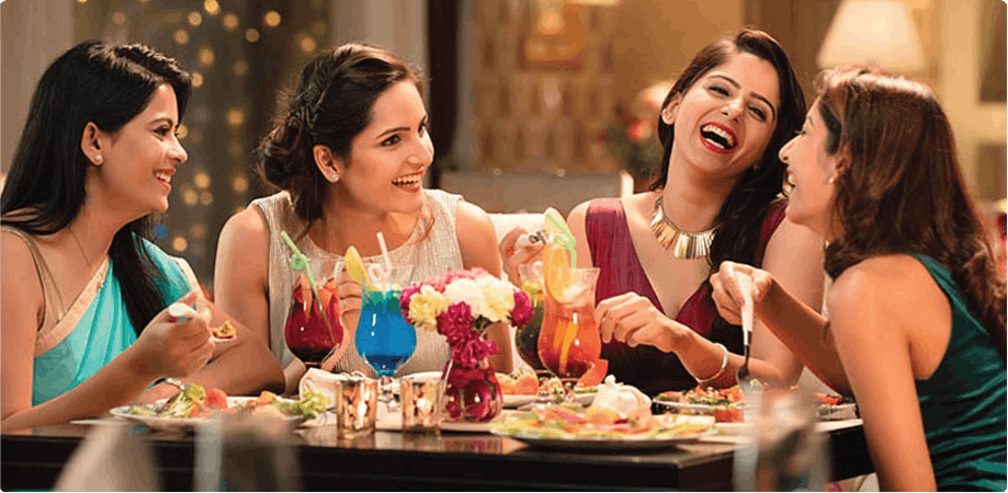 Four women enjoying a meal