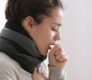 Woman with cough symptoms.