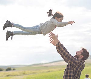 Father playing with his daughter.