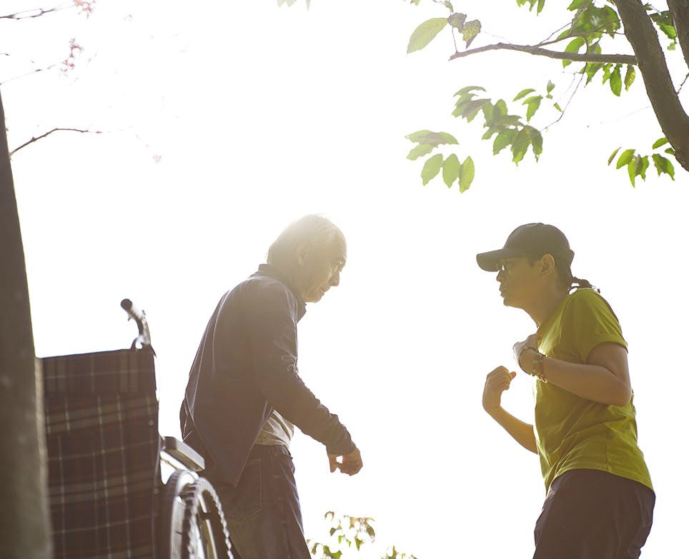 Older adult couple working out outdoors.