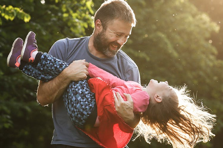 Father Swinging Daughter