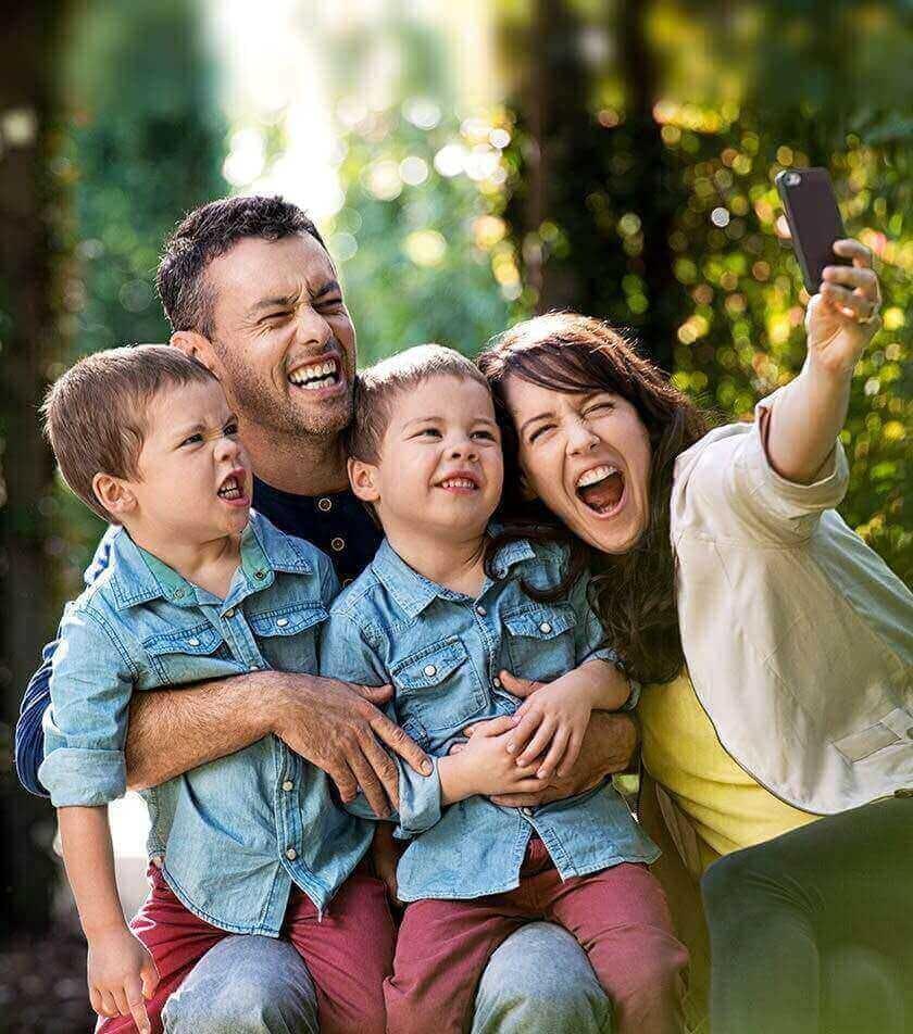 Parents With Children Taking Selfie
